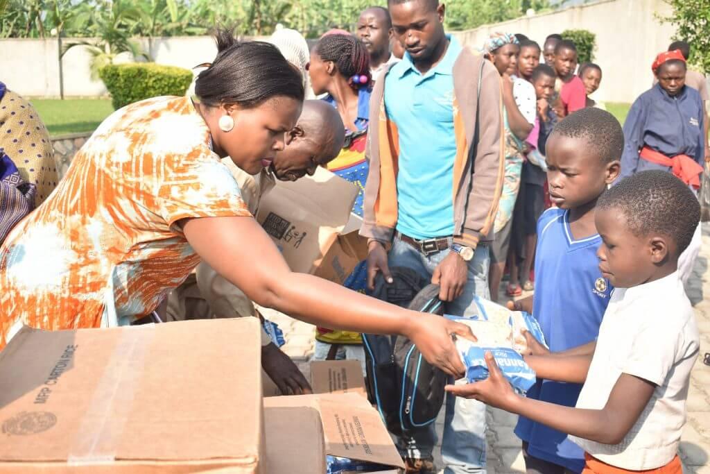 Pastor Doreen Mwesige giving out food in Bundibugyo